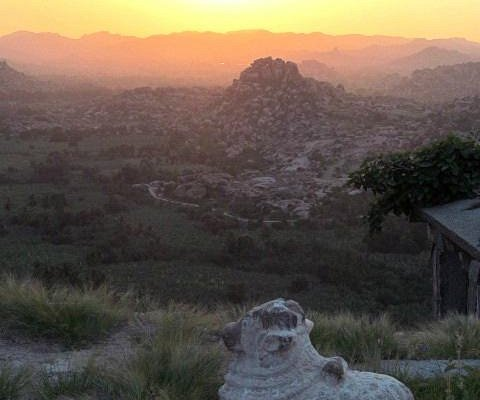 Watching the sunrise from the temple roof at Matanga Hill