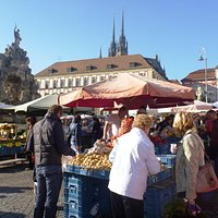 Market, fountain named Parnas and towers of Petrov