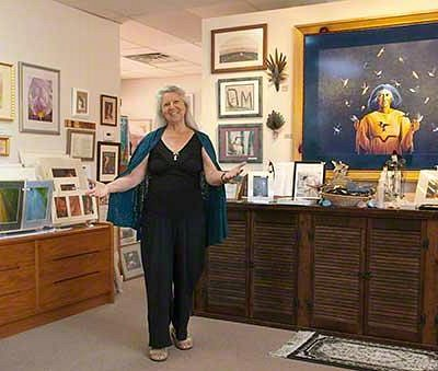 "Beth Kingsley Hawkins, owner, welcomes visitors to her ""everything hummingbird"" gallery."
