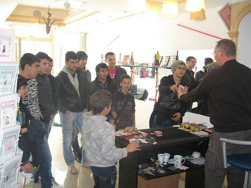 A crowd being entertained in my shop