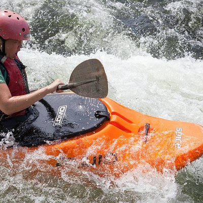 Tackling rapids during a week long beginners kayak course