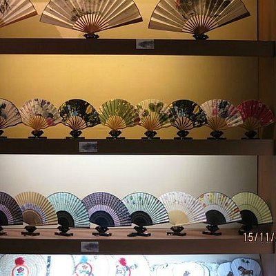 Many colorful fans for sale.