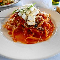Fresh tomato sauce with capers, olives and feta