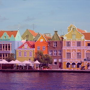 The colourful waterfront as seen from the Queen Emma Pontoon Bridge