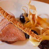 Roast loin of pork with parsnips, quince, prunes & roasting juices