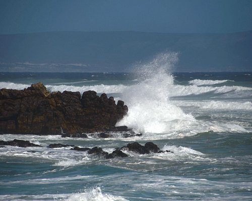 More crashing waves over the rocks out at sea.