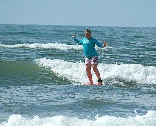 Catching a wave at Texas Surf Camp