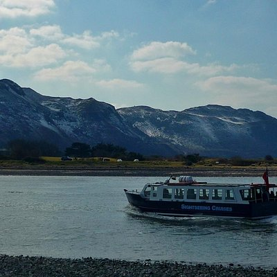 Conwy Sightseeing Cruise passing Deganwy beach on the way back to Conwy