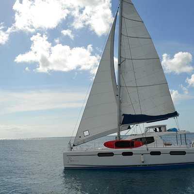 Seaduced Luxury Catamaran sailing off of Port St Charles