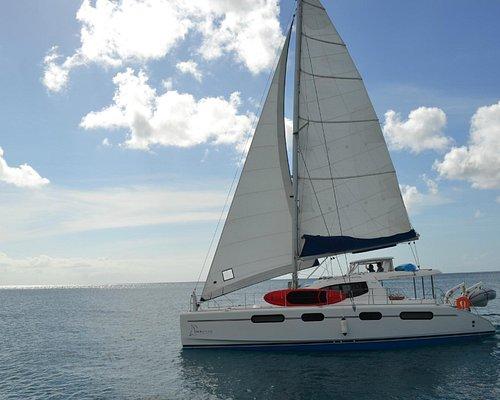 Seaduced Luxury Catamaran sailing off of Port St Charles