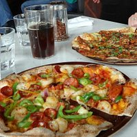 The 'rudi red' ale, lamb pizza and salami pizza. So delicious.