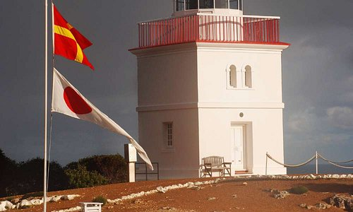 Cape Borda Lighthouse and flags