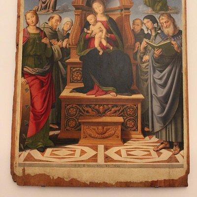Madonna in trono con santi. Lo Spagna