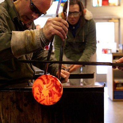 Students learn the fundamentals of glassblowing.