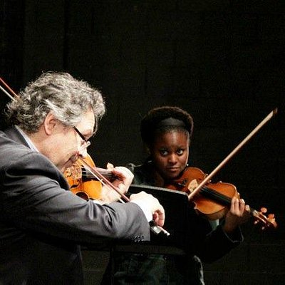 Artistic Director, Atis Bankas plays with fellow Gould String Quartet member, Tanya Charles.