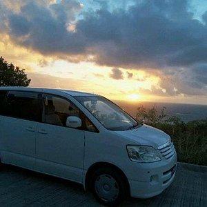 Island Man's Taxi at Sunset