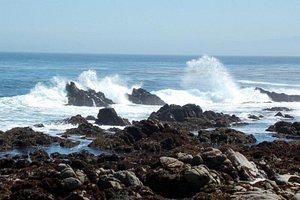 waves crash into the rocks
