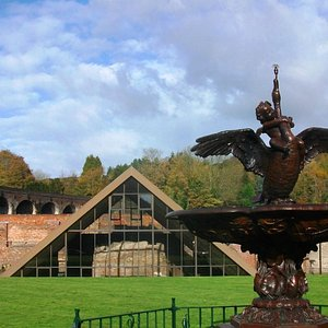 Boy And Swan fountain and the historic blast furnace where iron was first smelted from coke in 1