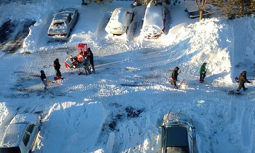 The amazing staff cleaning the cars and parking after the blizzard