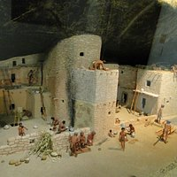 Exhibit with puebloans going about their day