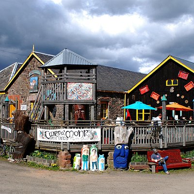 Tasting room, shop, deck and cafe guarded by giant heads