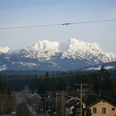 View of Arrowsmith Mountain covered in snow.