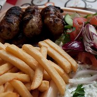 Seftalia with fries and salad