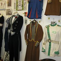 New display of old cinema uniforms from bygone days