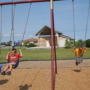 Swings, a large playground apparatus and more are avaiable for children at the park.