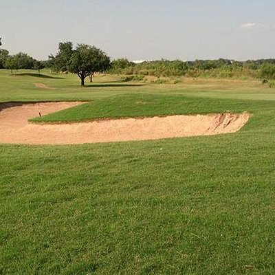 the smallest of all the green side bunkers
