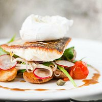 Pan fried powan fish with warm seasonal salad and poached egg