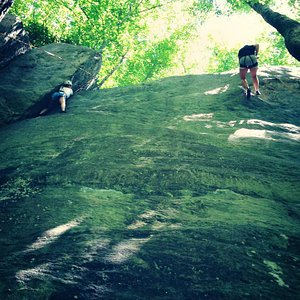 One friend climbing (left), the other repelling (right)