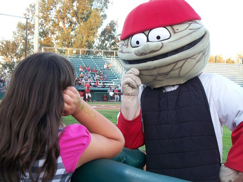 """""""Wally,"""" one of their two mascots, teasing a little girl."""