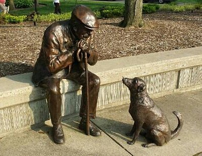 bronze man with his dog