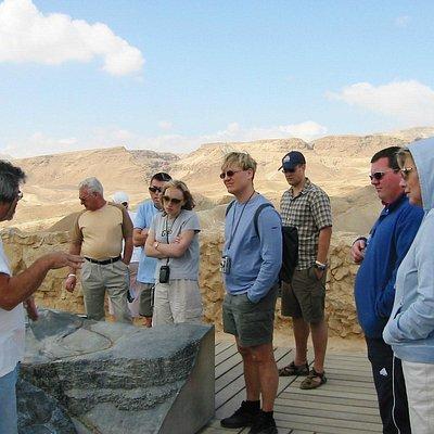 Udi Guberman guiding group at Masada