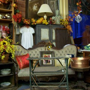 Antiques and collectibles fill the shop.