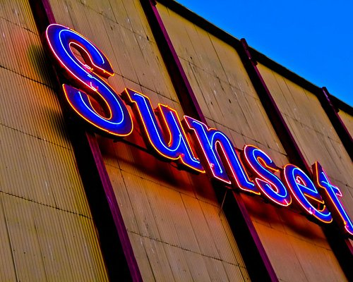 Sunset sign on the back of the screen