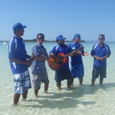 Serenading our guests during their Vow Renewal at the Sandbank before going snorkelling