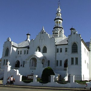 Italian Baroque, French Gothic, an Eastern dome, Belgium tower and Cape Dutch facades!