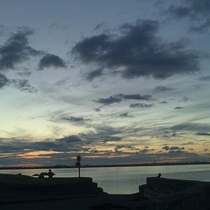 Clouds gathering as sun sets over Dublin - east of Seapoint beach
