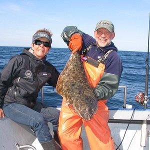 Mom with Dave and a 30 pound halibut! Seldovia, Alaska