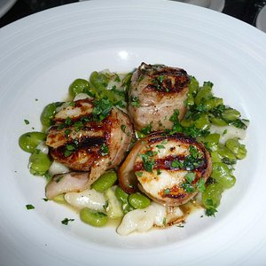 Fabulous broiled scallops with fava beans and potato gnocci