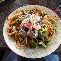 Seared tuna steak served with Asian noodles and vegetables ($ 18)