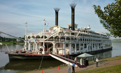 American Queen docked by hotel