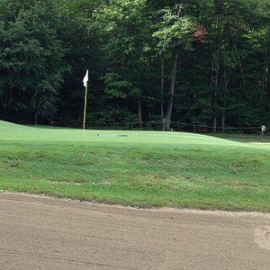 Approach to 9th green shows typical course quality.
