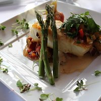 Chilean Sea Bass special with mango salsa, mashed potatoes and vegetables