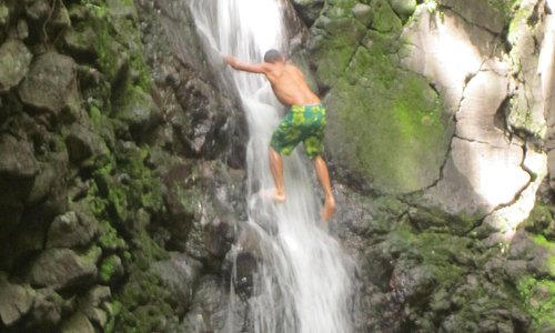 Our Guide Climbing the Waterfall