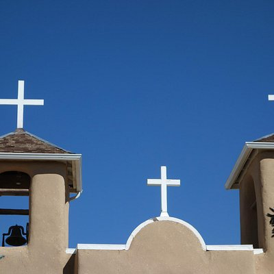White crosses against that blue NM sky