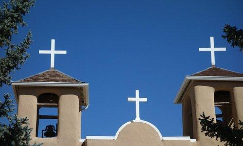 White crosses against that blue NM sky