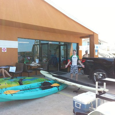 Outside Ocean City Surf with their Stand Up Paddleboards